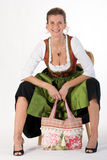 Elderly woman in Bavarian costume dress with bag Royalty Free Stock Photography