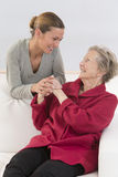 Elderly woman and beautiful granddaughter full complic Royalty Free Stock Photos