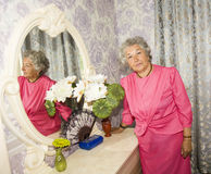 Elderly woman in bedroom Royalty Free Stock Photography