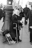 The elderly woman begs. On the city street Royalty Free Stock Photos