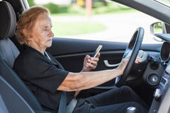 Elderly woman behind the steering wheel Stock Photography