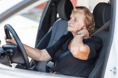 Elderly woman behind the steering wheel Royalty Free Stock Photo