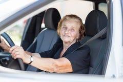 Elderly woman behind the steering wheel stock image