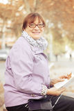 Elderly woman   on   bench Royalty Free Stock Photo