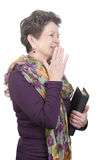 Elderly woman with bible and a giggle Royalty Free Stock Image