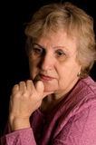 The elderly woman on black Stock Photos