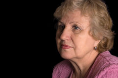 The elderly woman on black background Stock Image