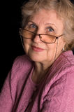 The elderly woman on black background Royalty Free Stock Photos