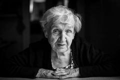 An elderly woman. Black-and-white close-up portrait. Stock Photos