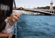 Elderly woman boat trip. Elderly woman on the boat tourists tour on the Seine river, in Paris stock photo