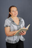 The elderly woman and the book. Stock Images