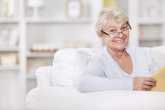 An elderly woman with a book Royalty Free Stock Images
