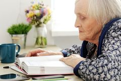 Elderly woman with book Royalty Free Stock Photos
