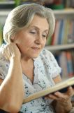 Elderly woman with book Royalty Free Stock Images