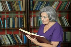 Elderly woman with book Stock Photo