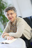 Elderly woman with a book Royalty Free Stock Photos