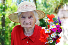 Elderly woman with a bouquet Stock Photo