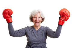 Elderly woman with boxing gloves Royalty Free Stock Photos
