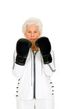 Elderly woman with boxing gloves Royalty Free Stock Photo