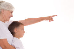 Elderly woman and boy Stock Images