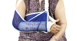 Elderly woman with a broken arm on a plaster cast Stock Image