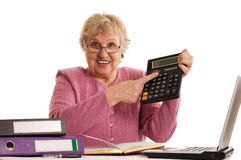 The elderly woman with the calculator. On white Royalty Free Stock Photos