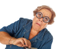 Elderly woman with calculator Stock Photo