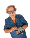 Elderly woman with calculator Stock Image
