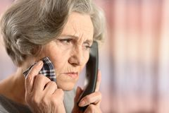 Elderly woman calling Royalty Free Stock Photo