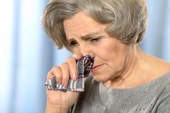 Elderly woman calling Royalty Free Stock Image