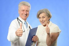 Elderly woman came to the doctor Stock Photography