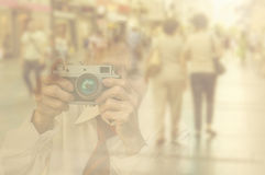 Elderly woman with camera.  Double exposure image with unrecogni Stock Photos