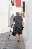 An elderly woman with a cane Stock Photo