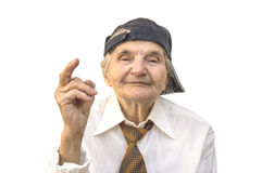 Elderly woman with cap showing middle finger. Stock Photo