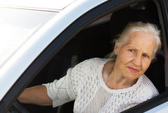 Elderly woman in the car. Attentive elderly woman driving car Royalty Free Stock Images
