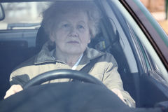 Elderly woman in car royalty free stock images