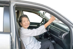 Elderly woman on car Stock Photography