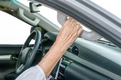 Elderly woman on car Stock Photo