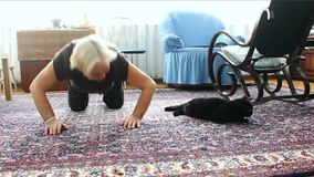 An elderly woman and a cat. Exercises