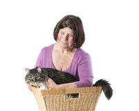 Elderly woman with a cat in a wicker basket. Royalty Free Stock Photo