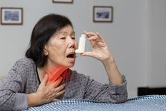Free Elderly Woman Choking And Holding An Asthma Spray Stock Photo - 100234830
