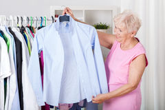 Elderly woman choosing an outfit Royalty Free Stock Photos