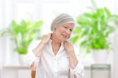 Senior woman acute shoulder pain. Elderly woman with chronic pain syndrome fibromyalgia suffering from acute shoulder pain stock photography