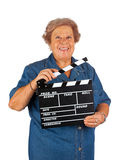 Elderly woman with clapper board Stock Photography