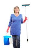 Elderly woman with cleaning Royalty Free Stock Photo