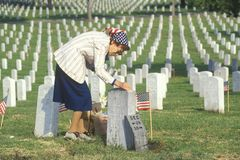 Elderly Woman Cleaning Grave Royalty Free Stock Photography