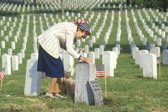 Elderly Woman Cleaning Grave, Los Angeles, California Stock Photography