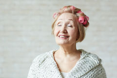 Elderly woman with closed eyes Royalty Free Stock Image
