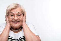 Elderly woman closes her mouth, ears and eyes with Stock Images