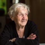 An elderly woman, closeup portrait. Happy. Stock Images